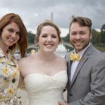 bride and groom with photographer by reflecting pool in DC