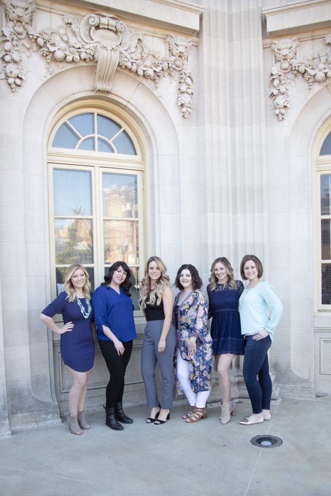 6 stylish women posing for professional photo