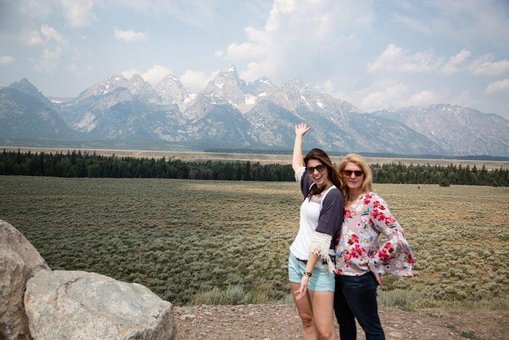 ladies posing with Teton mountains