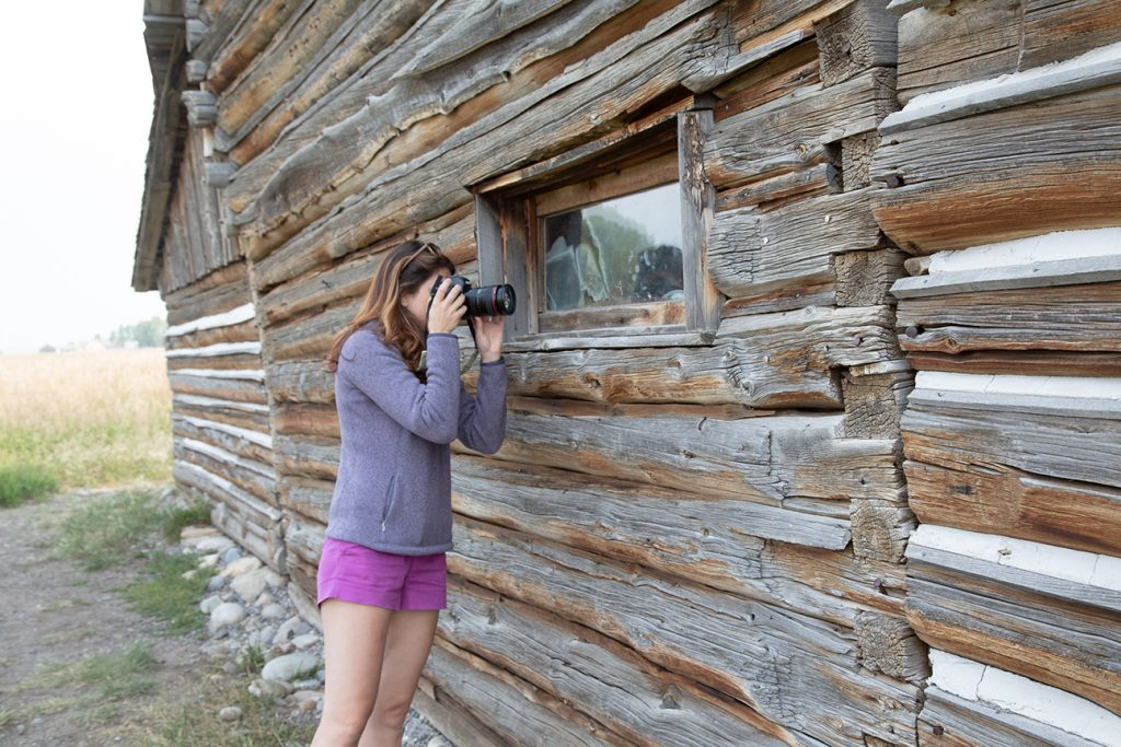 lady photographing barn