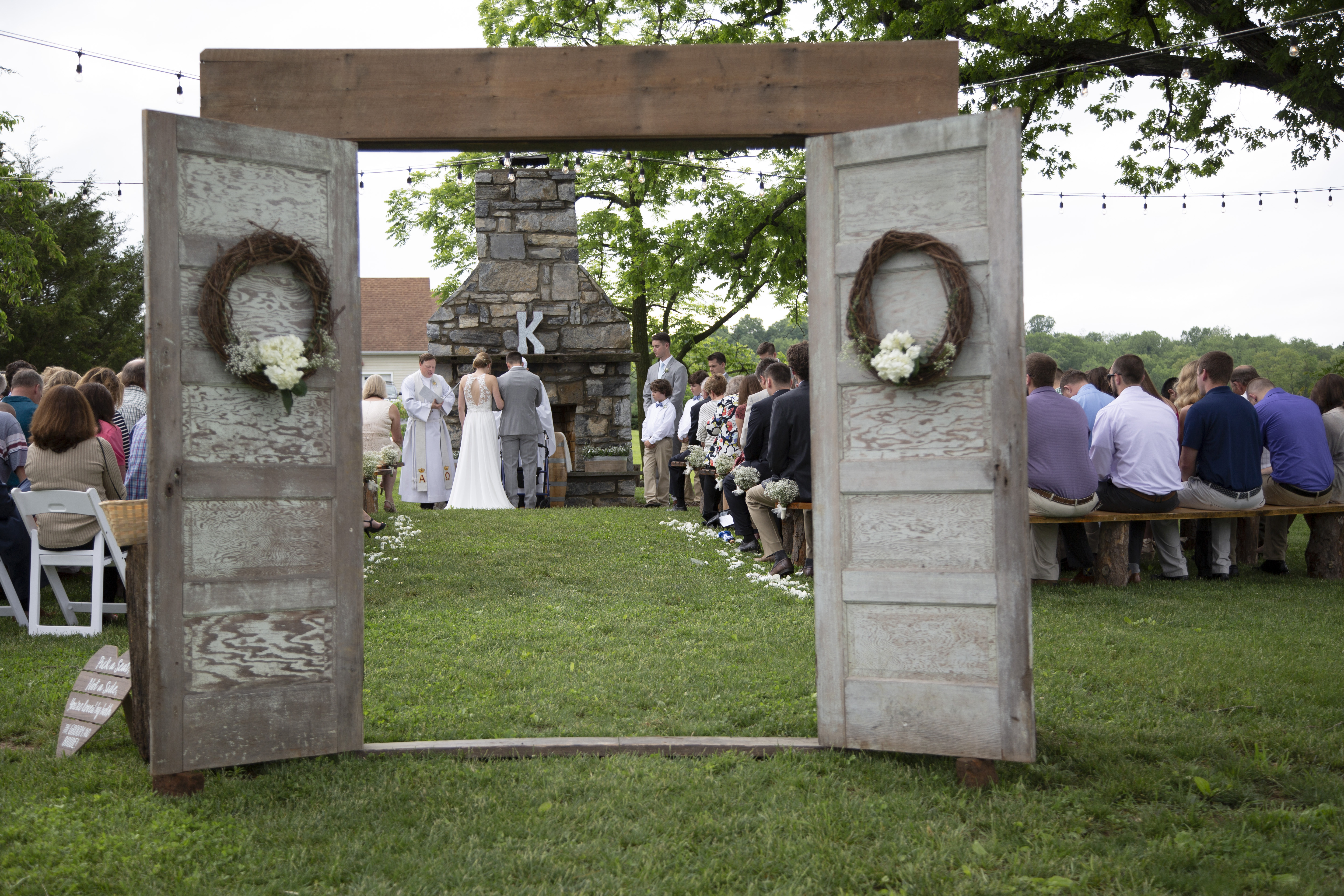 outdoor wedding ceremony with vintage doors