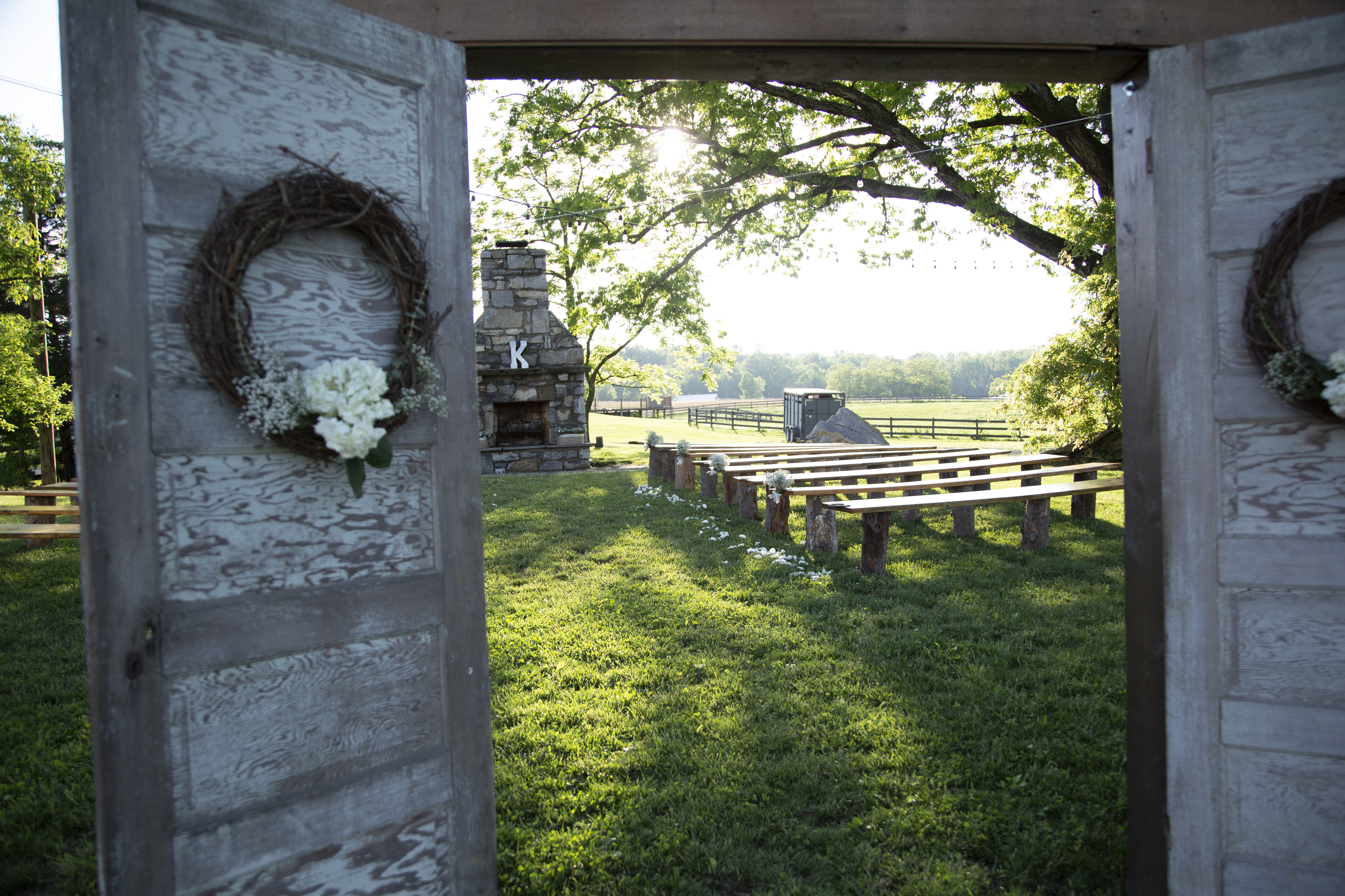 outdoor ceremony setup with stone fireplace