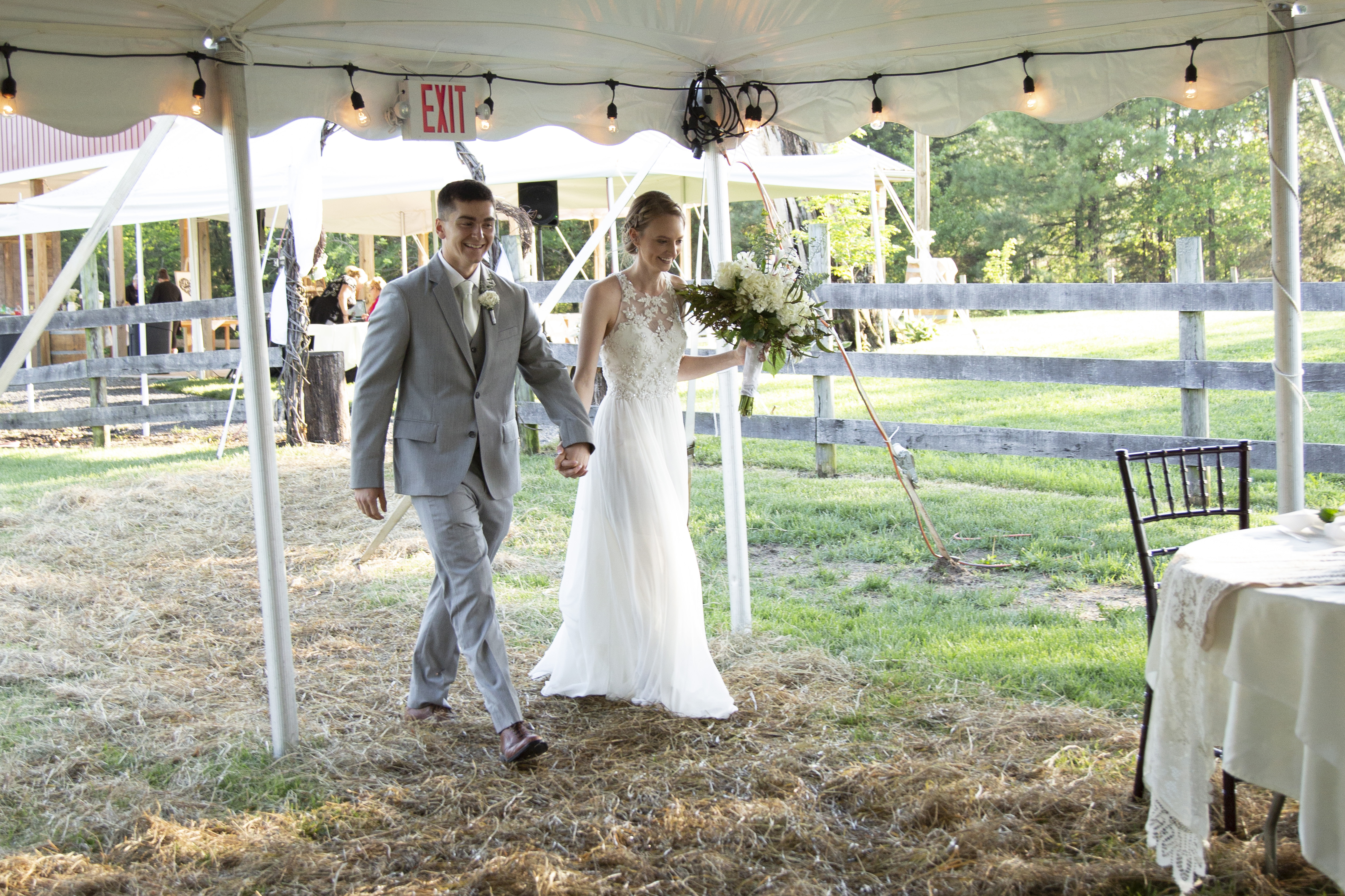 bride and groom entering reception tent