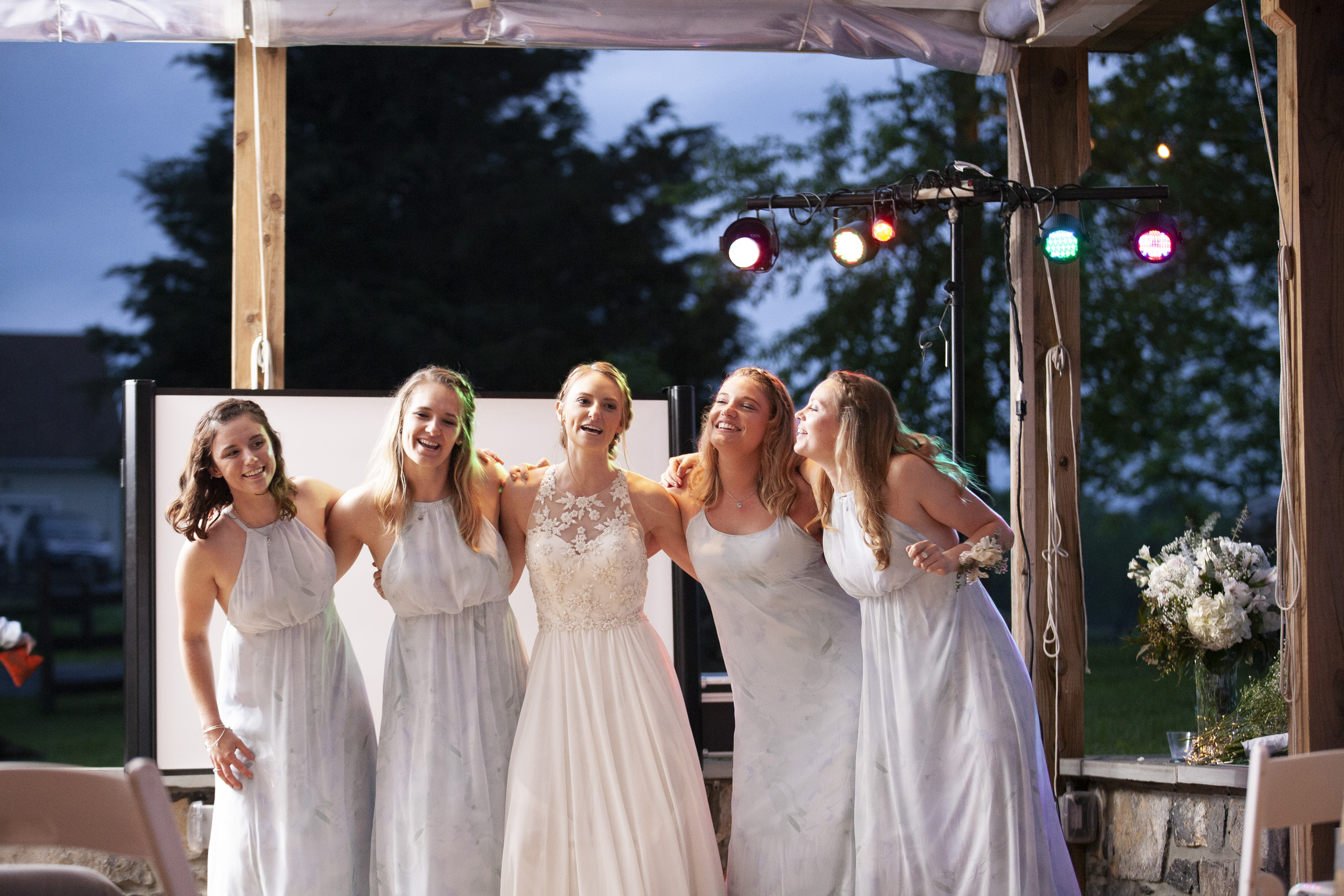 bride and bridesmaid signing and dancing