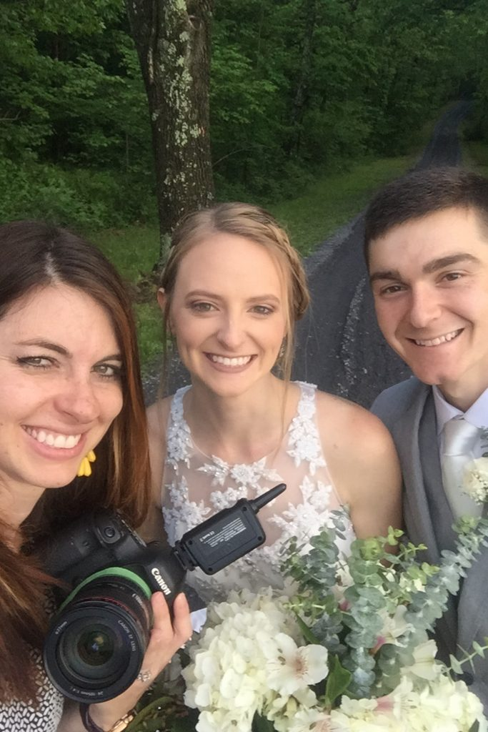 bride and groom with photographer