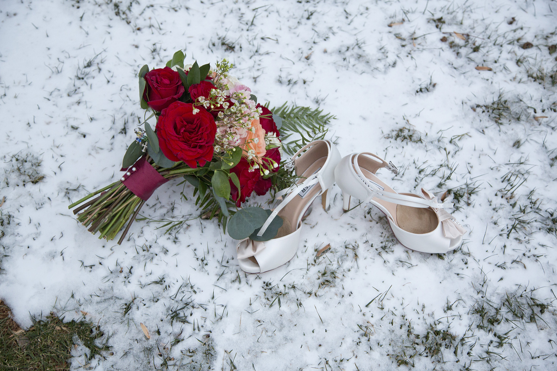 white high heels and bouquet in the snow