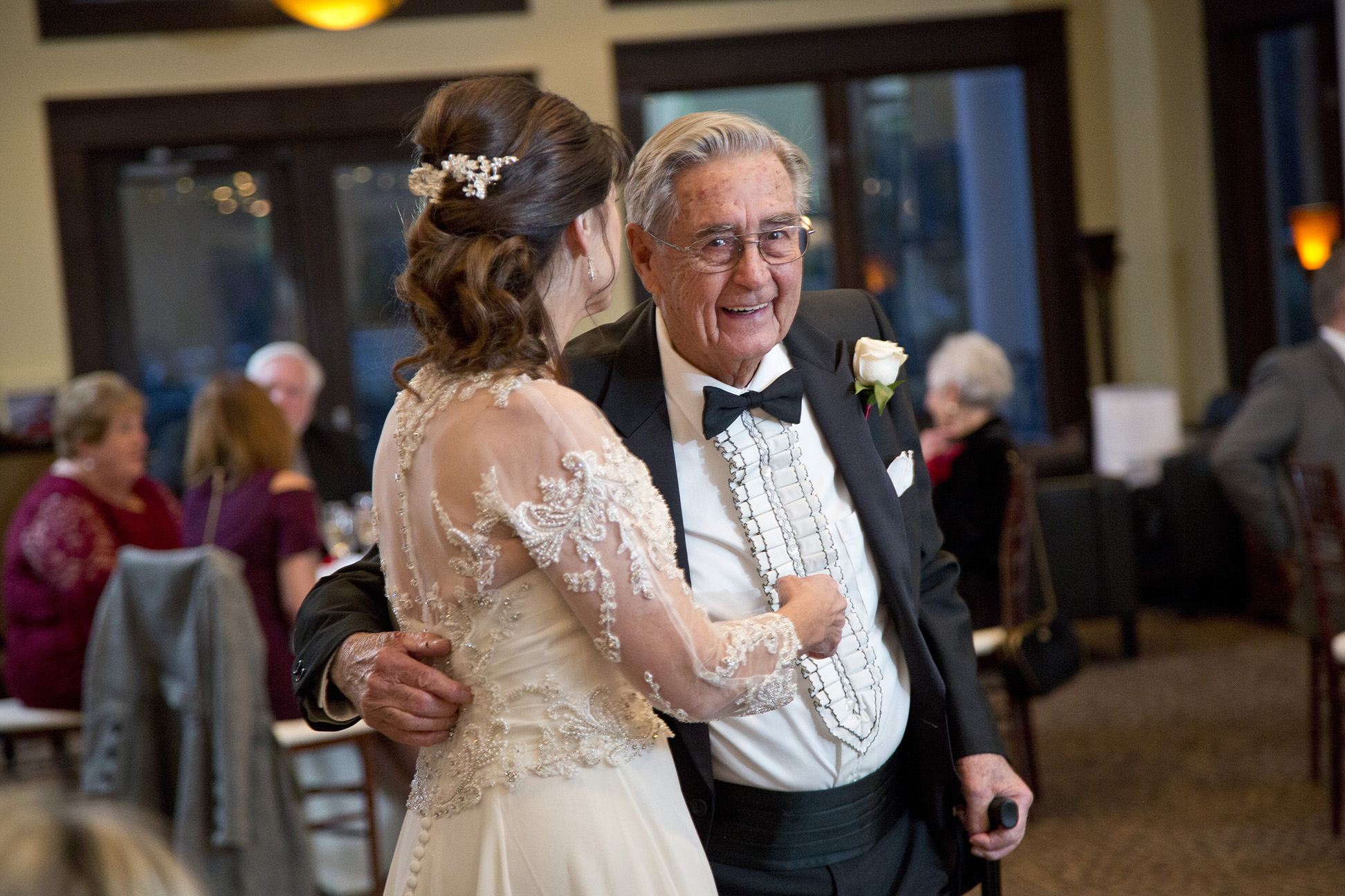 father of the brie smiling at camera during father daughter dance