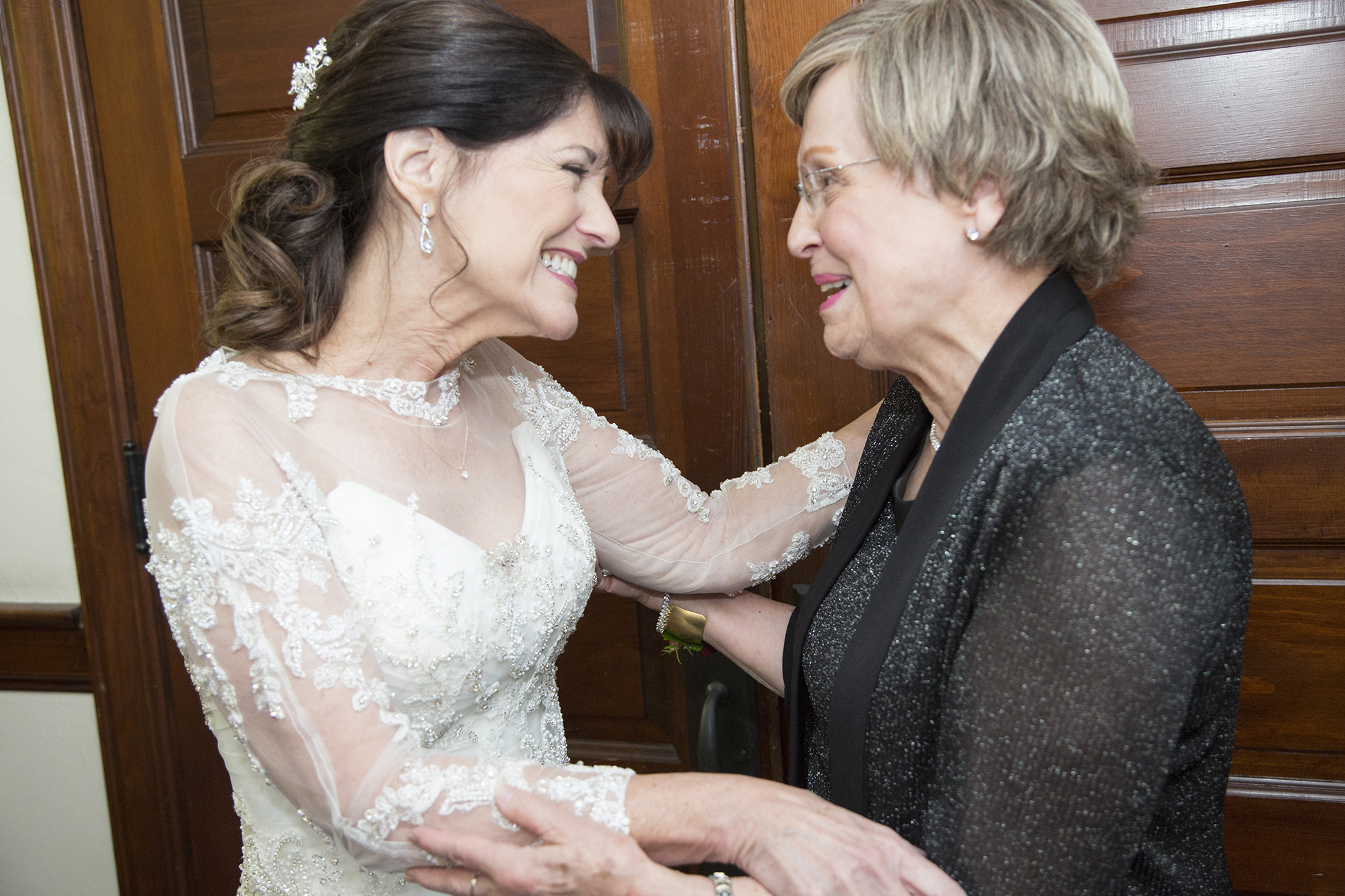 bride and mother in law embrace
