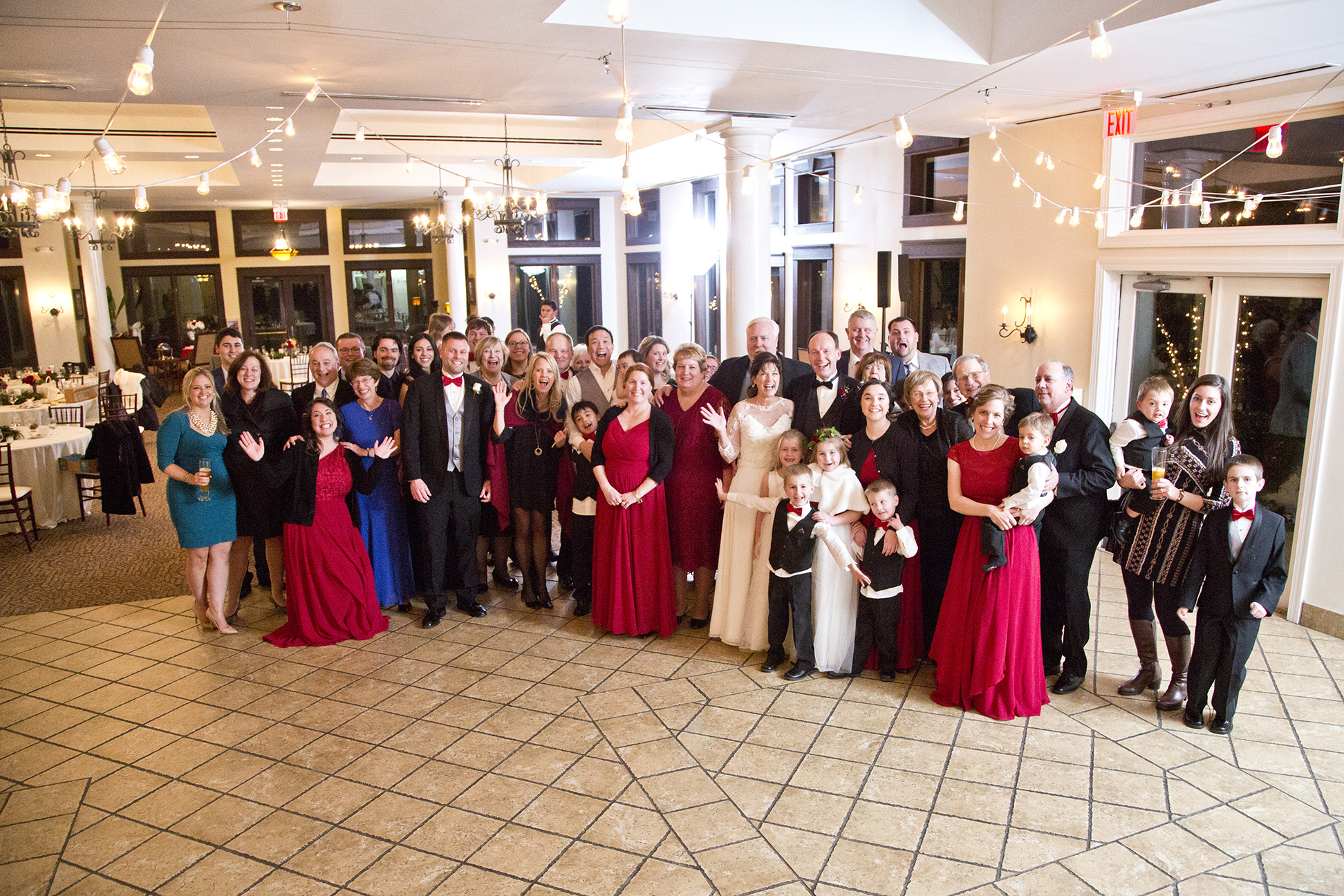 entire wedding guest list posing for photo at reception