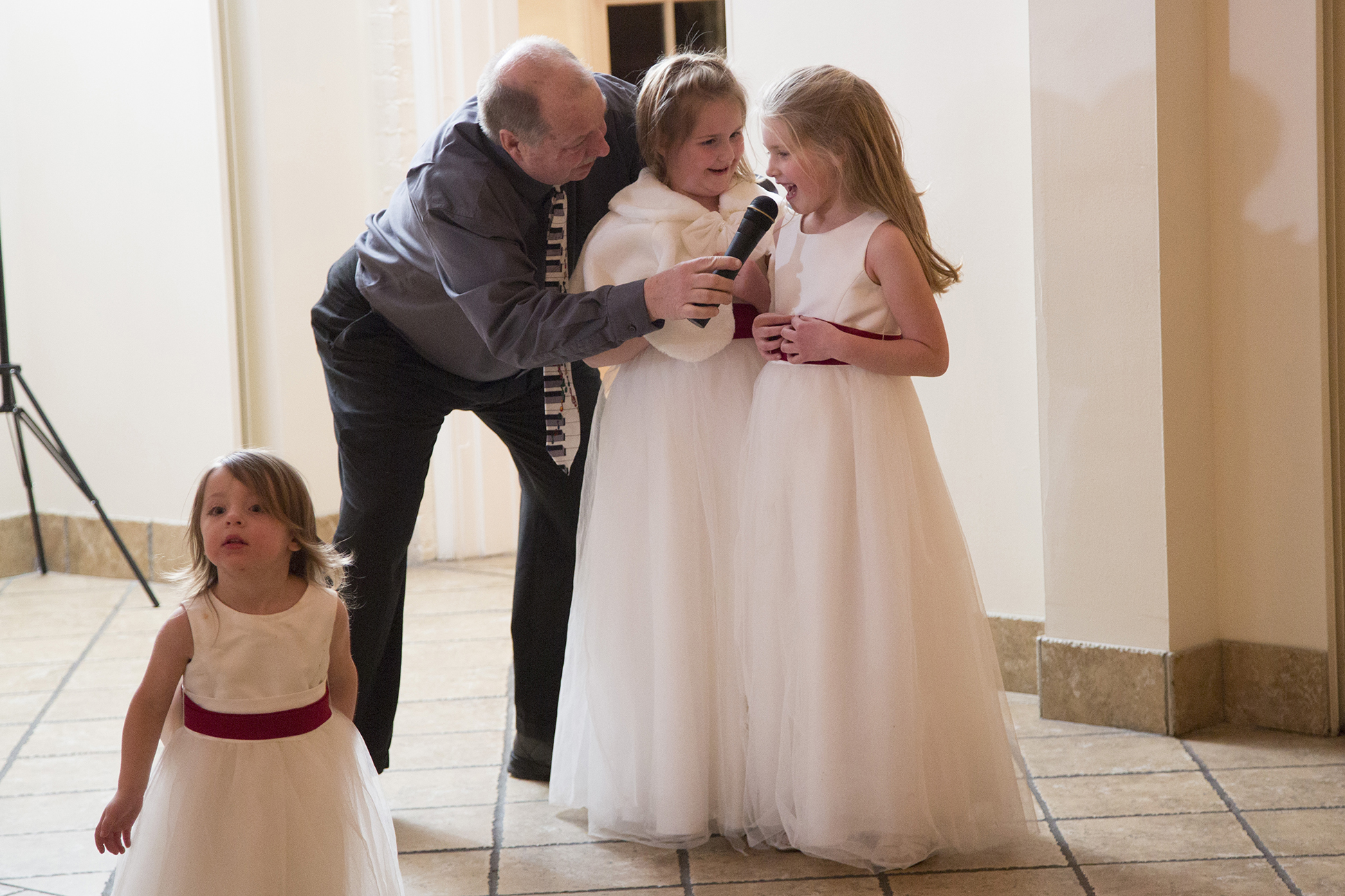 DJ letting flower girls sing into microphone