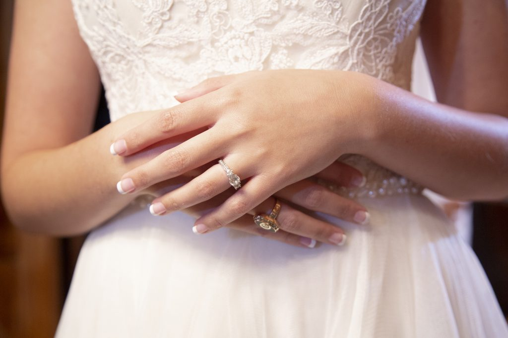 bride with arms crossed, close up on hands