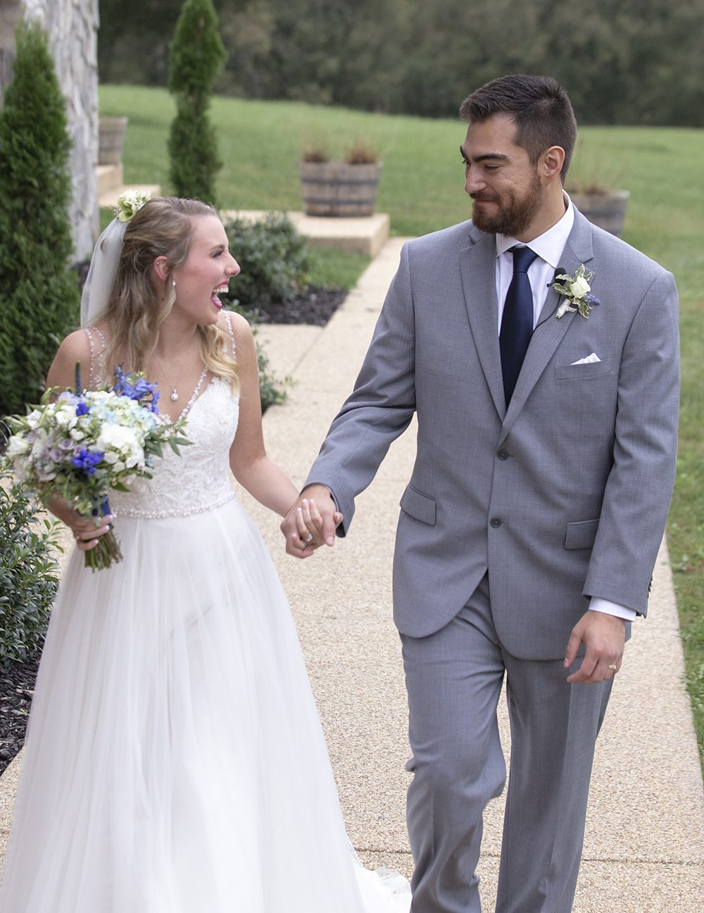 bride and groom walking toward camera