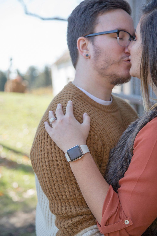 couple kisses after surprise proposal