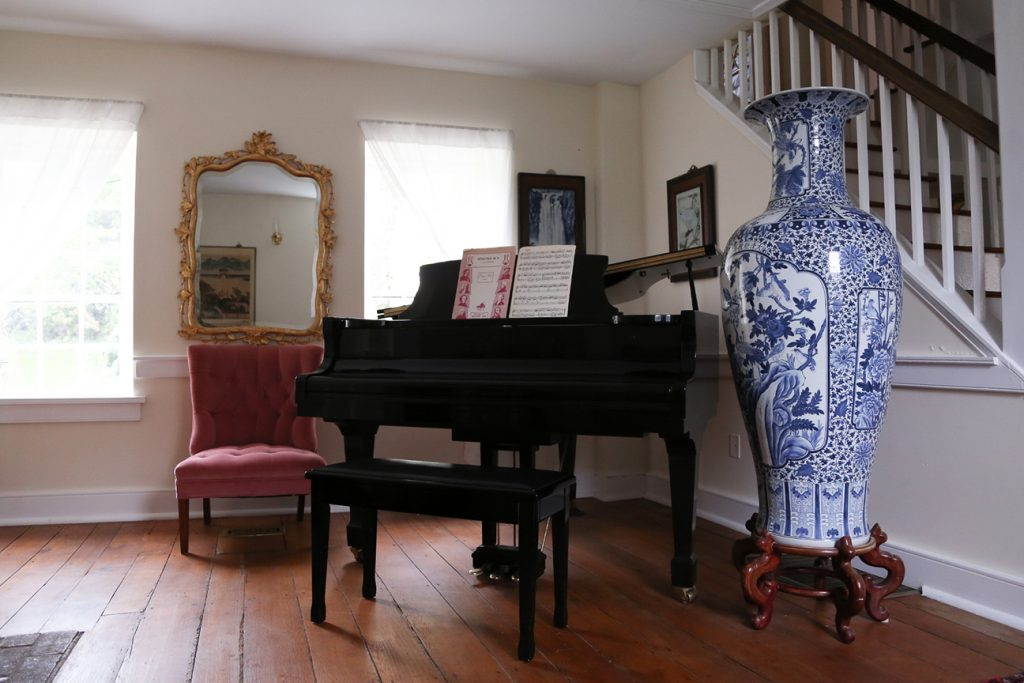 large vase ad piano in living room