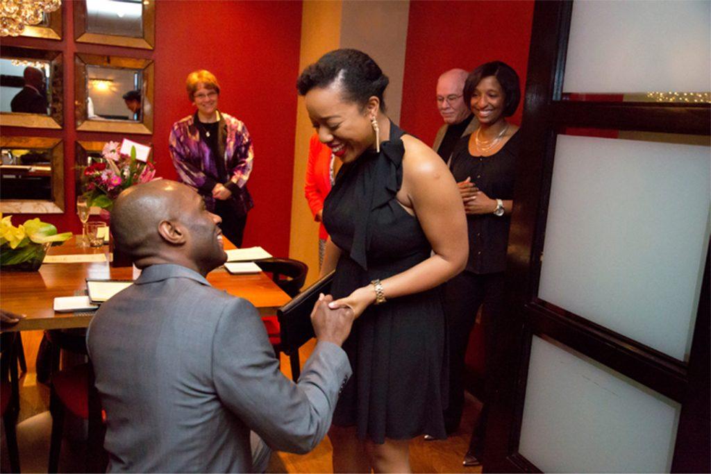 man on knee proposing to woman