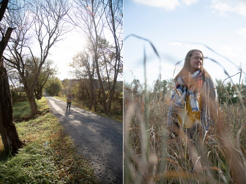 teenage girl standing in field during fall