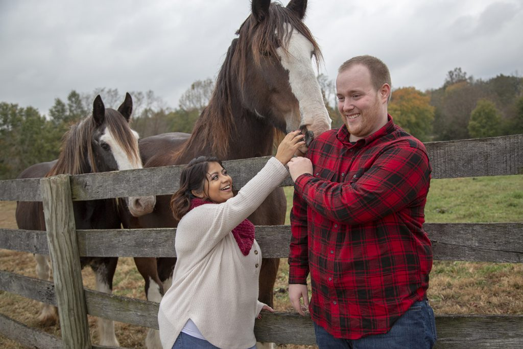 engaged couple with horse