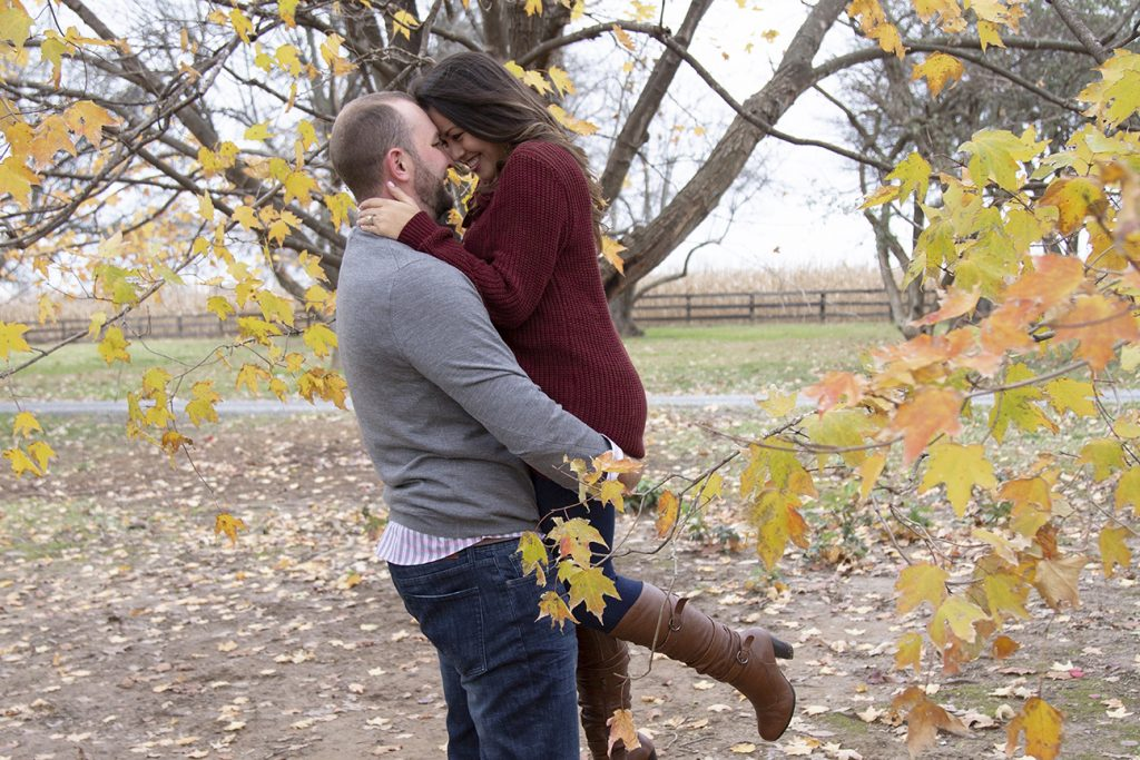 couple embracing in fall forest