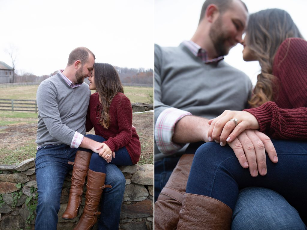 couple sitting on stone wall head to head