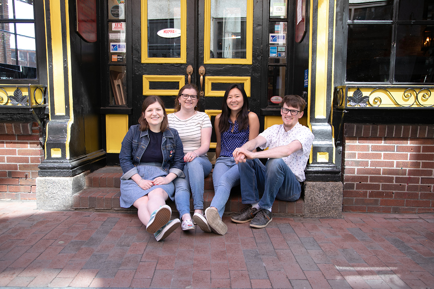 young adults sitting on stoop