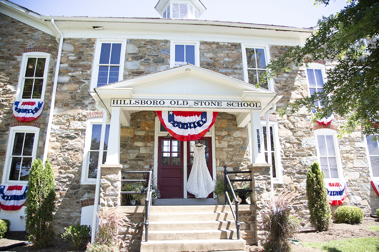 old stone school house with wedding dress hanging