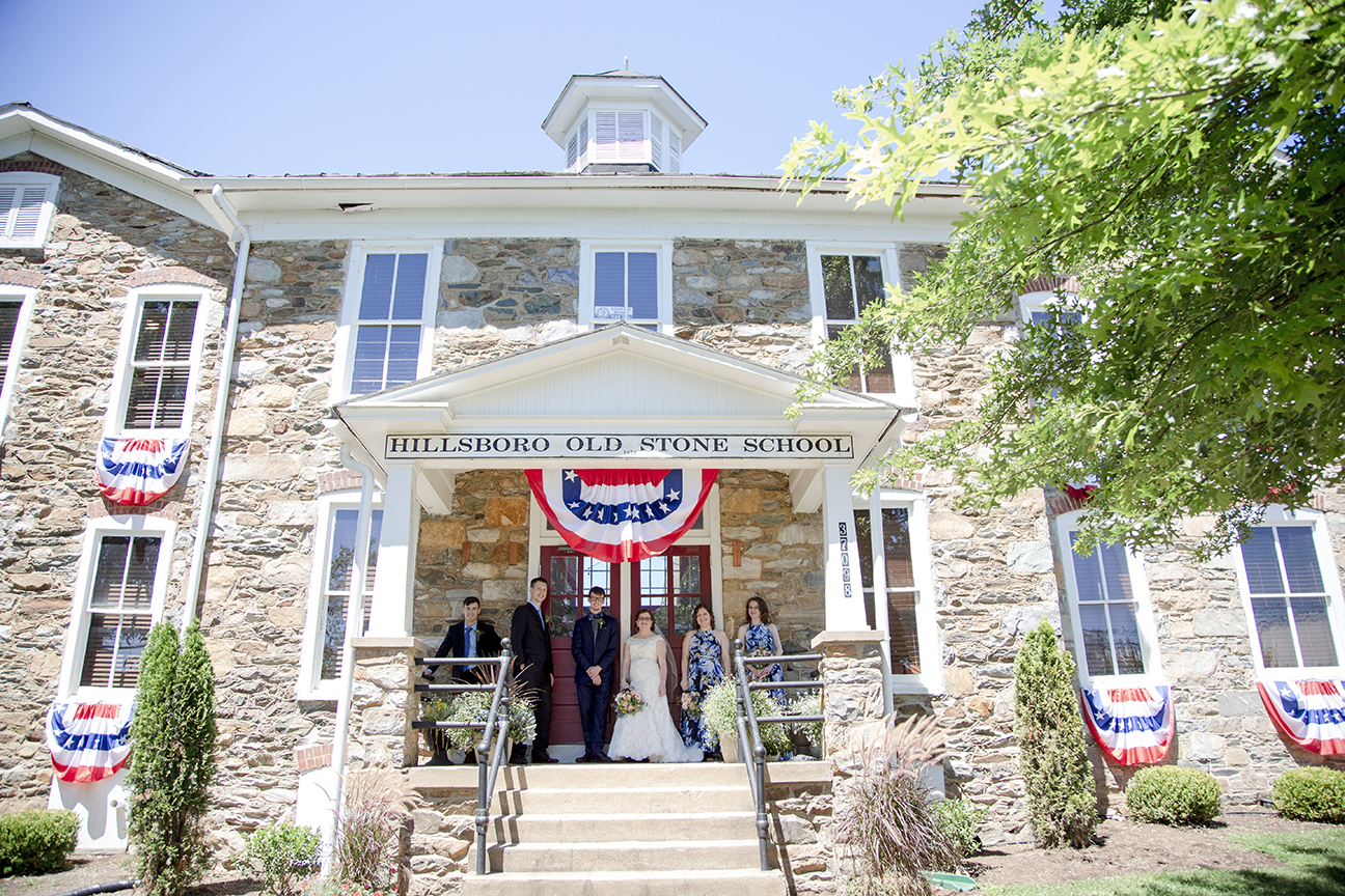 wedding party on front steps of old stone school
