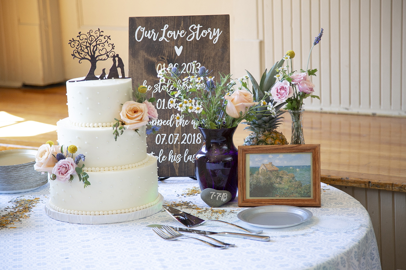 cake table and flowers inside old stone school