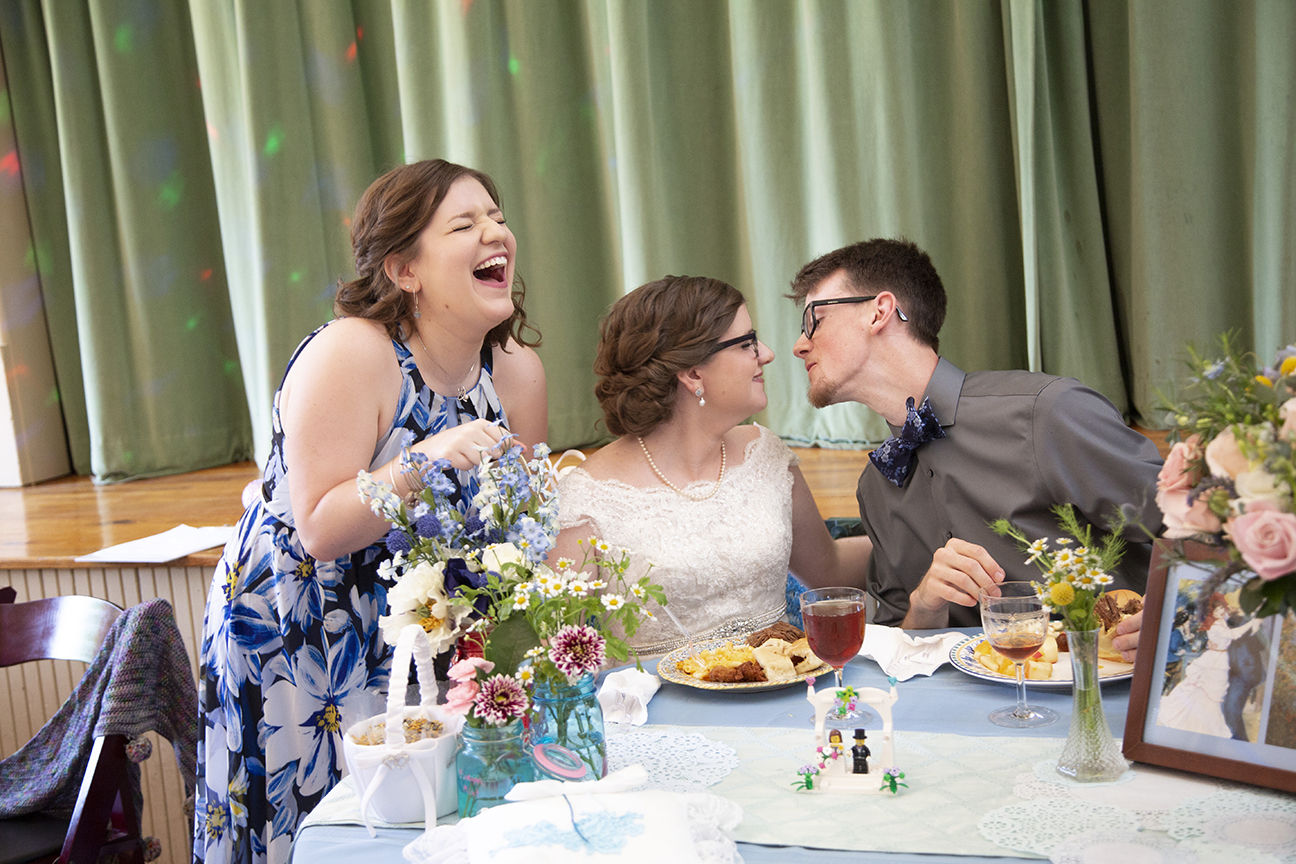 laughter at reception in old stone school