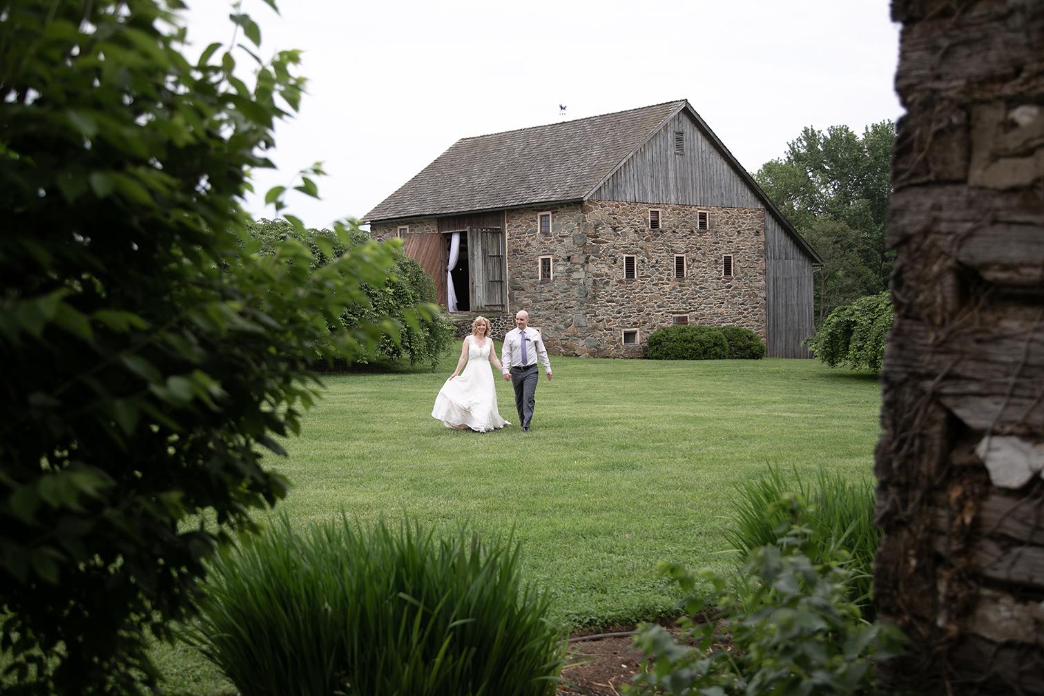 couple walking by barn