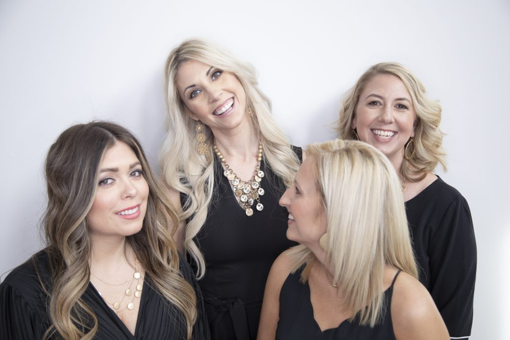 4 women laughing in branding outtake photo