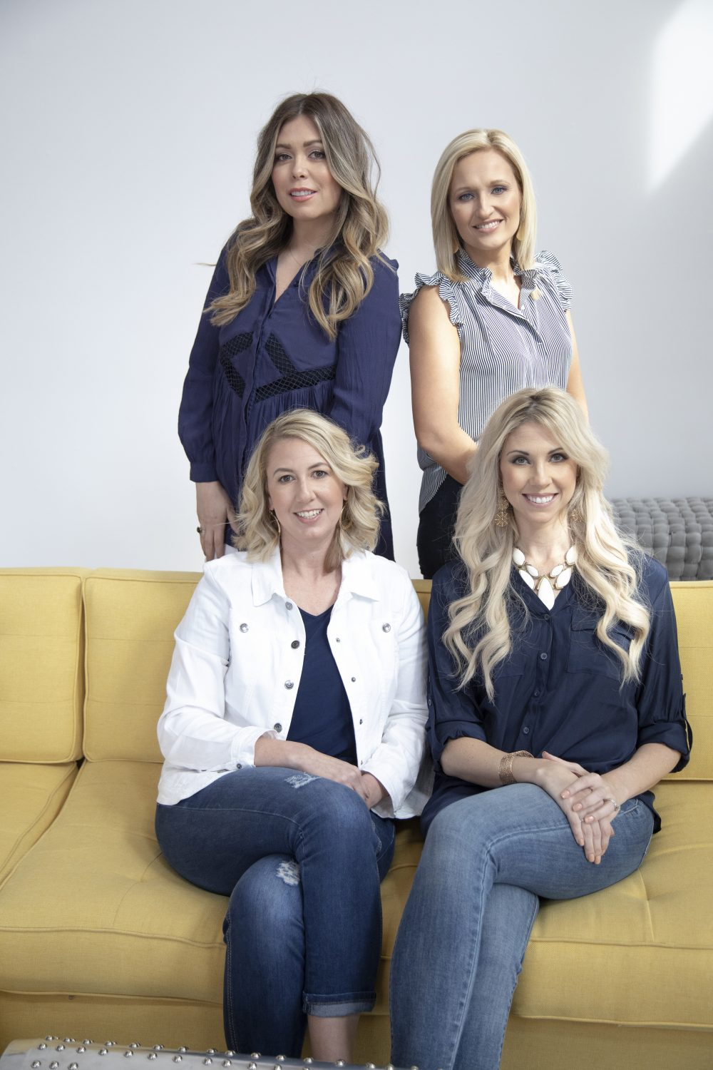 four women posing for business photo shoot