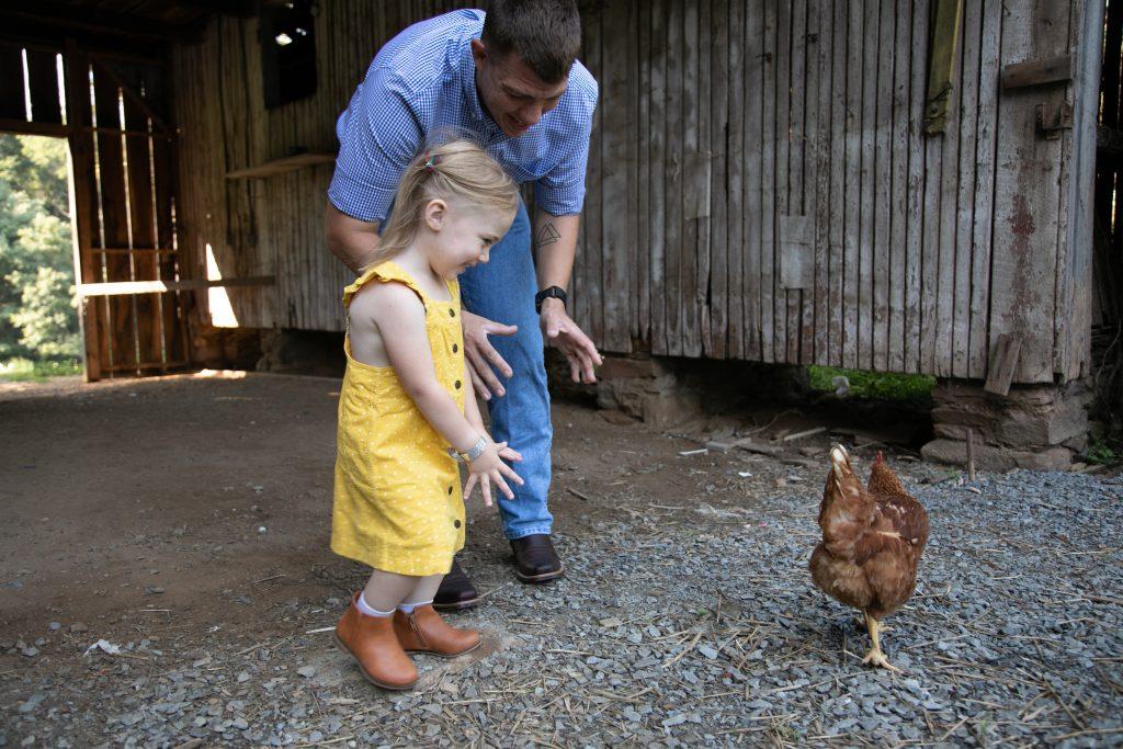 family photos at Ballenger farm with chicken