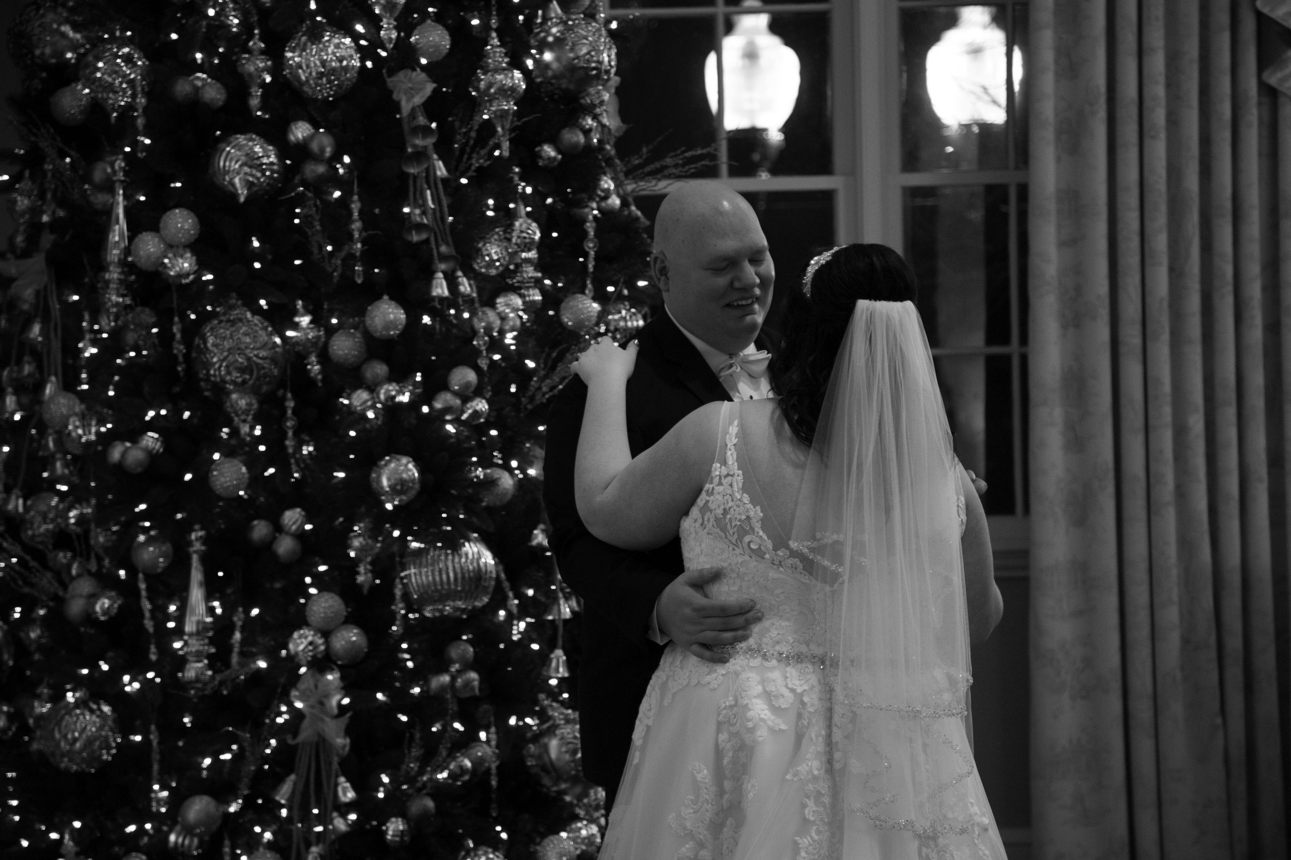 first dance in front of christmas tree. George Washington hotel christmas wedding.