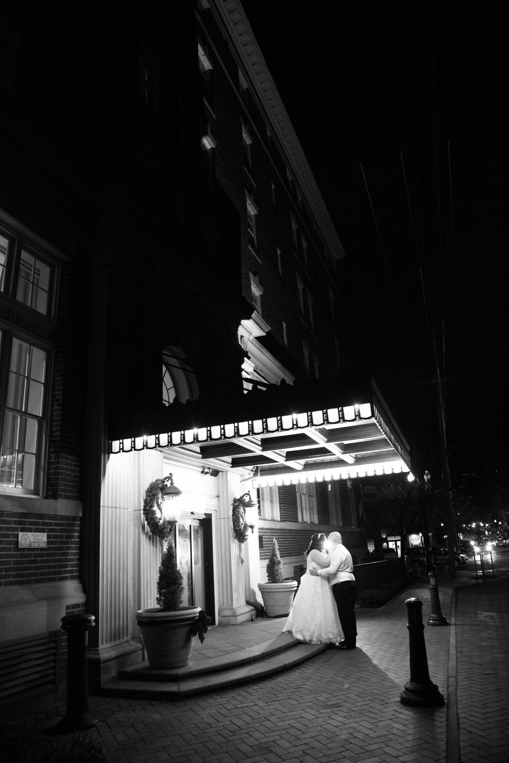 Last kiss of the night. Bride and groom posing in old town winchester. George Washington hotel Christmas wedding