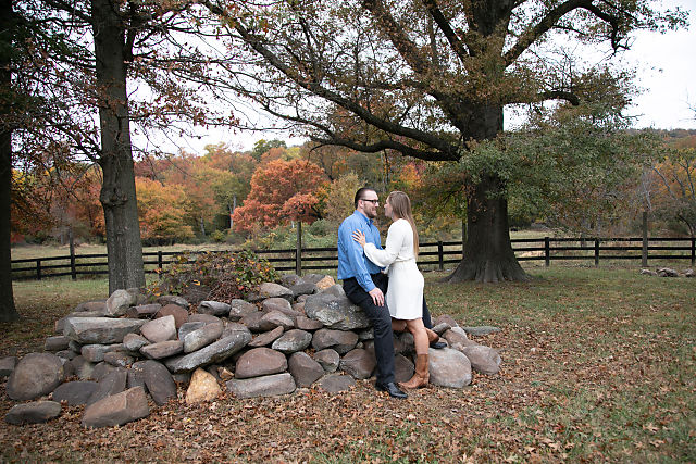 couple posing on rock pile at doukenie winery