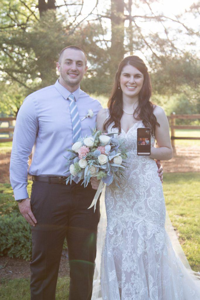 Loudoun County micro wedding couple posing with brides parents via FaceTime